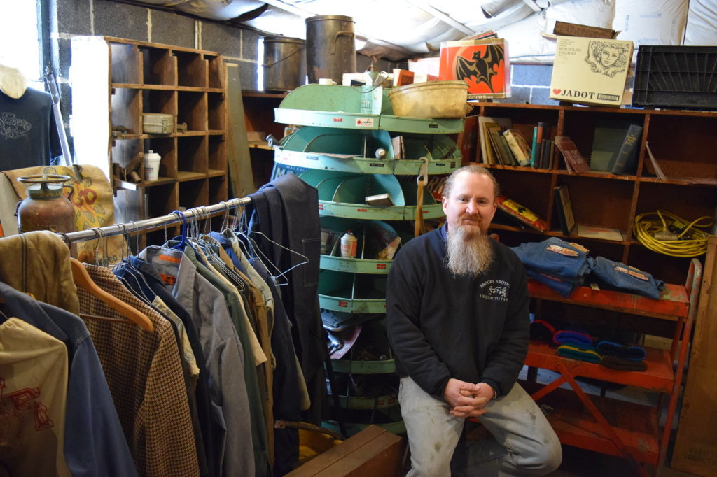 "Anthony Brooks in his ""Blue Collar Vintage Salvage"" shop"