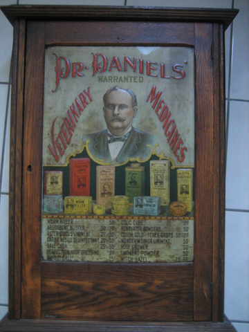 Dr. Daniels tin litho advertising cabinet