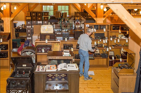 An interested bidder checks out the antique/vintage radios in the one-of-a-kind collection we auctioned